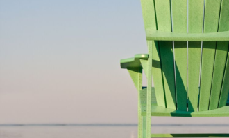 Are you committed to a vision? - green chair on a deck overlooking the ocean