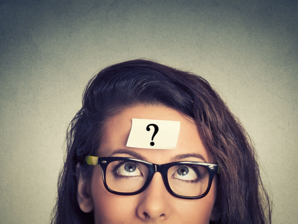 woman in glasses with question mark